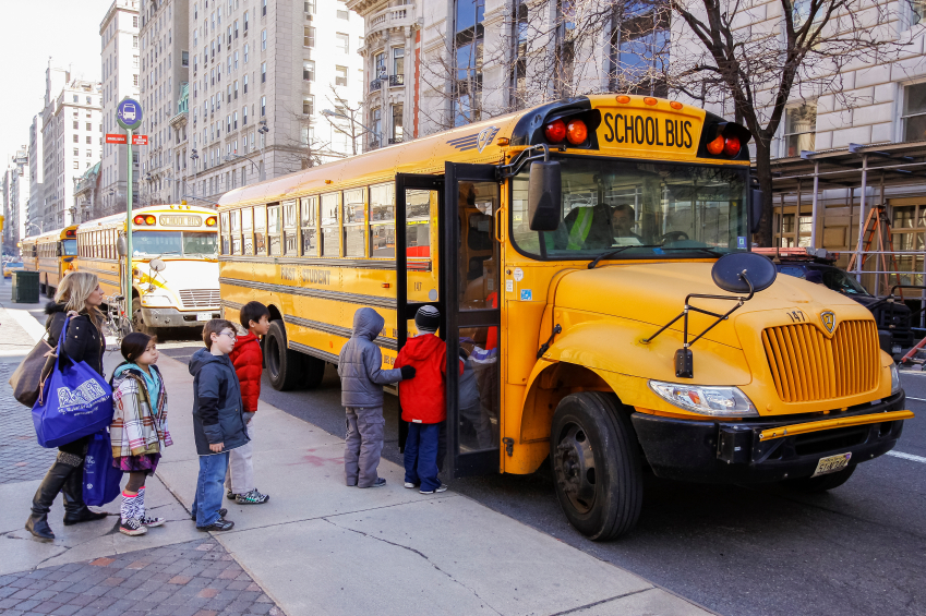 New York City, USA - March 03, 2011: Children entering school bus in the center of Vew Your City.