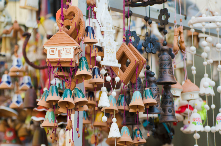 Souvenir ceramic bells and toy houses at the market, local national craft of Ukraine